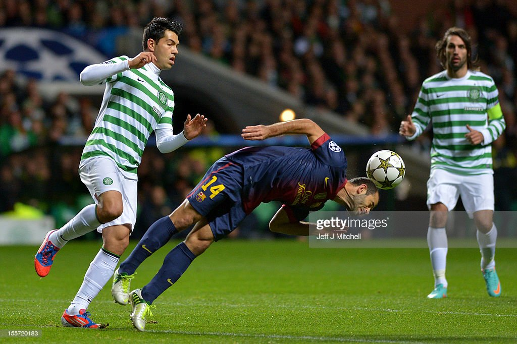 Miku of Celtic tackles Javier Mascherano of Barcelona during the UEFA Champions League Group G match between Celtic and Barcelona at Celtic Park on November 7, 2012 in Glasgow, Scotland.