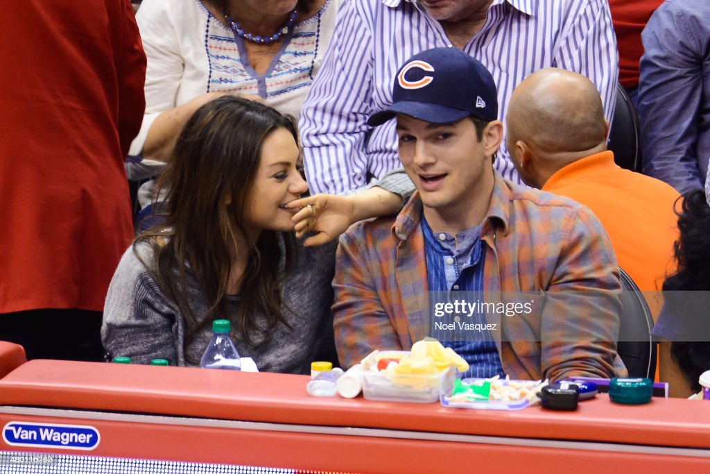Mila Kunis (L) and Ashton Kutcher attend a basketball between the Detroit Pistons and the Los Angeles Clippers at Staples Center on March 22, 2014 in Los Angeles, California.