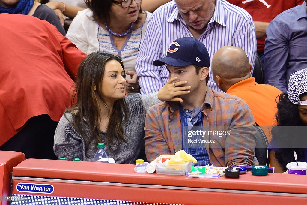 <a gi-track='captionPersonalityLinkClicked' href=/galleries/search?phrase=Mila+Kunis&family=editorial&specificpeople=212845 ng-click='$event.stopPropagation()'>Mila Kunis</a> (L) and <a gi-track='captionPersonalityLinkClicked' href=/galleries/search?phrase=Ashton+Kutcher&family=editorial&specificpeople=202015 ng-click='$event.stopPropagation()'>Ashton Kutcher</a> attend a basketball between the Detroit Pistons and the Los Angeles Clippers at Staples Center on March 22, 2014 in Los Angeles, California.
