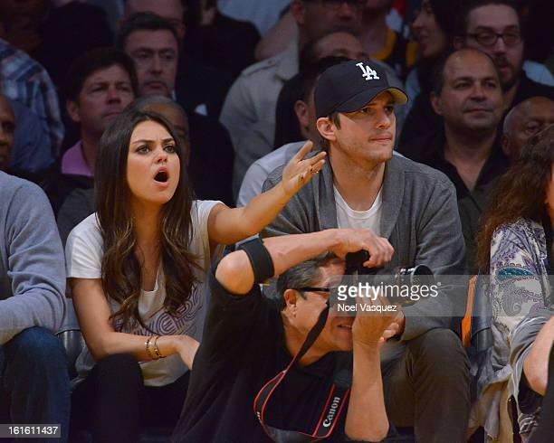 Mila Kunis and Ashton Kutcher attend a basketball game between the Phoenix Suns and the Los Angeles Lakers at Staples Center on February 12 2013 in...