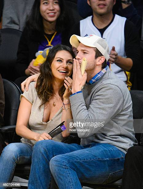 Mila Kunis and Ashton Kutcher attend a basketball game between the Oklahoma City Thunder and the Los Angeles Lakers at Staples Center on December 19...