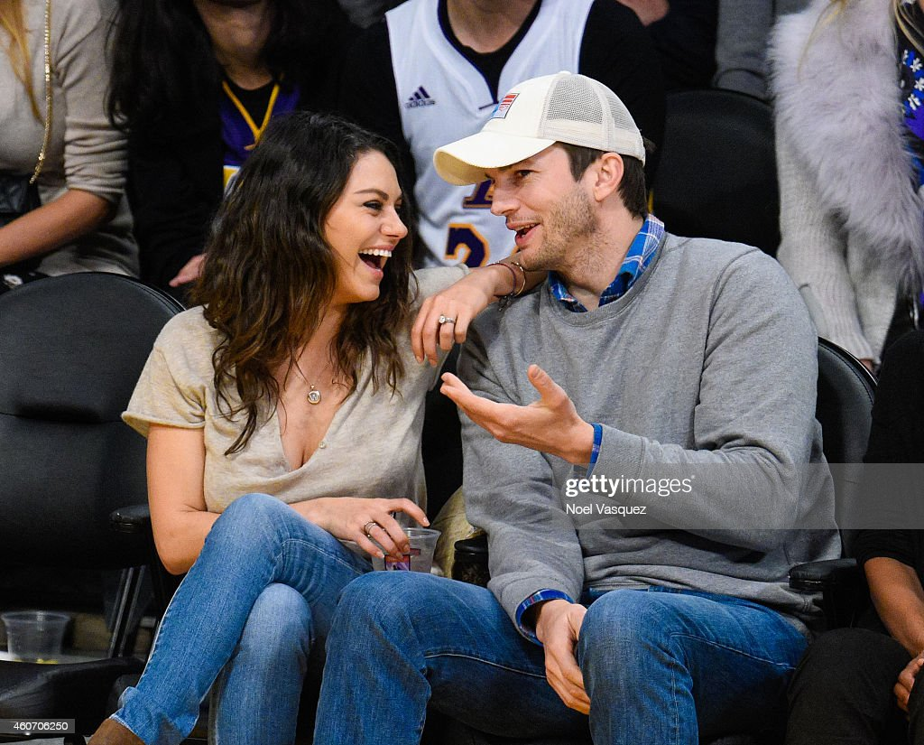 <a gi-track='captionPersonalityLinkClicked' href=/galleries/search?phrase=Mila+Kunis&family=editorial&specificpeople=212845 ng-click='$event.stopPropagation()'>Mila Kunis</a> (L) and <a gi-track='captionPersonalityLinkClicked' href=/galleries/search?phrase=Ashton+Kutcher&family=editorial&specificpeople=202015 ng-click='$event.stopPropagation()'>Ashton Kutcher</a> attend a basketball game between the Oklahoma City Thunder and the Los Angeles Lakers at Staples Center on December 19, 2014 in Los Angeles, California.