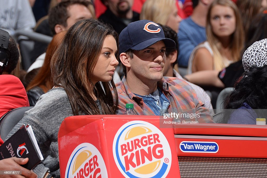 Mila Kunis and Ashton Kutcher attend a game between the Los Angeles Clippers and the Detroit Pistons at STAPLES Center on March 22, 2014 in Los Angeles, California.