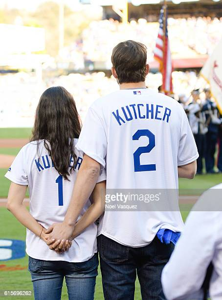 Mila Kunis and Ashton Kutcher attend game 4 of the NLCS between the Chicago Cubs and the Los Angeles Dodgers at Dodger Stadium on October 19 2016 in...