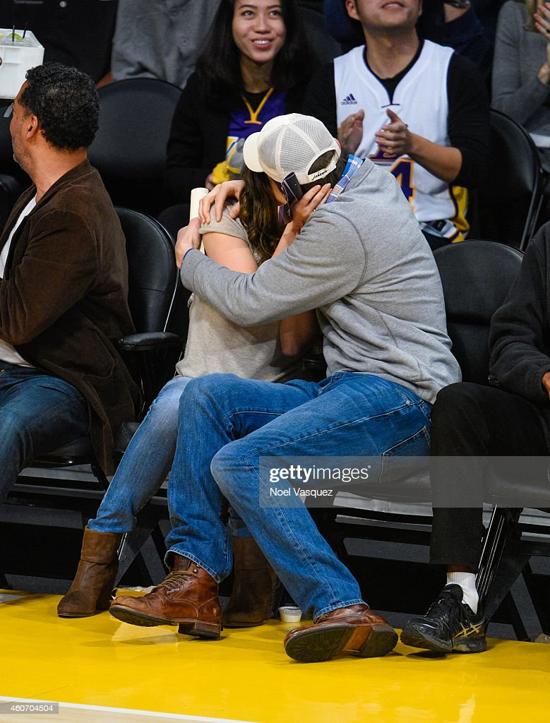 Mila Kunis and Ashton Kutcher kiss at a basketball game between the Oklahoma City Thunder and the Los Angeles Lakers at Staples Center on December 19...