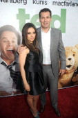Mila Kunis and Scott Stuber arrives for the premiere of 'Ted' at Grauman's Chinese Theatre on June 21 2012 in Hollywood California