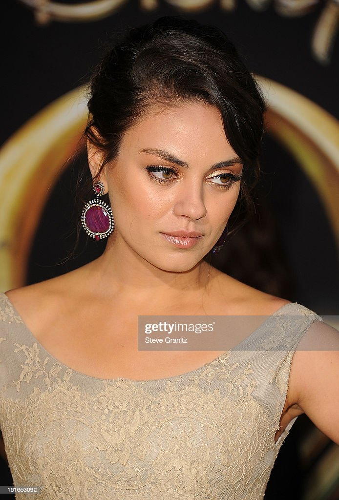 Mila Kunis arrives at the 'OZ The Great And Powerful' - Los Angeles Premiere at the El Capitan Theatre on February 13, 2013 in Hollywood, California.