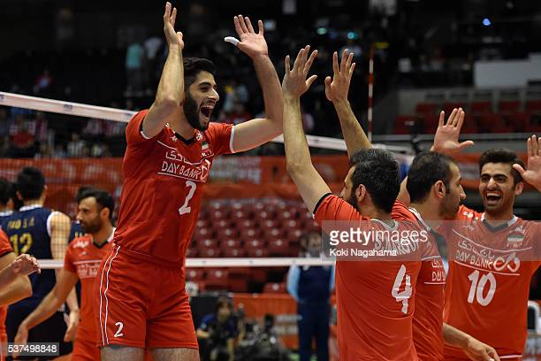 Milad Ebadipour Ghara H #2 of Iran highfives Mir Saeid Marouflakrani during the Men's World Olympic Qualification game between Iran and China at...