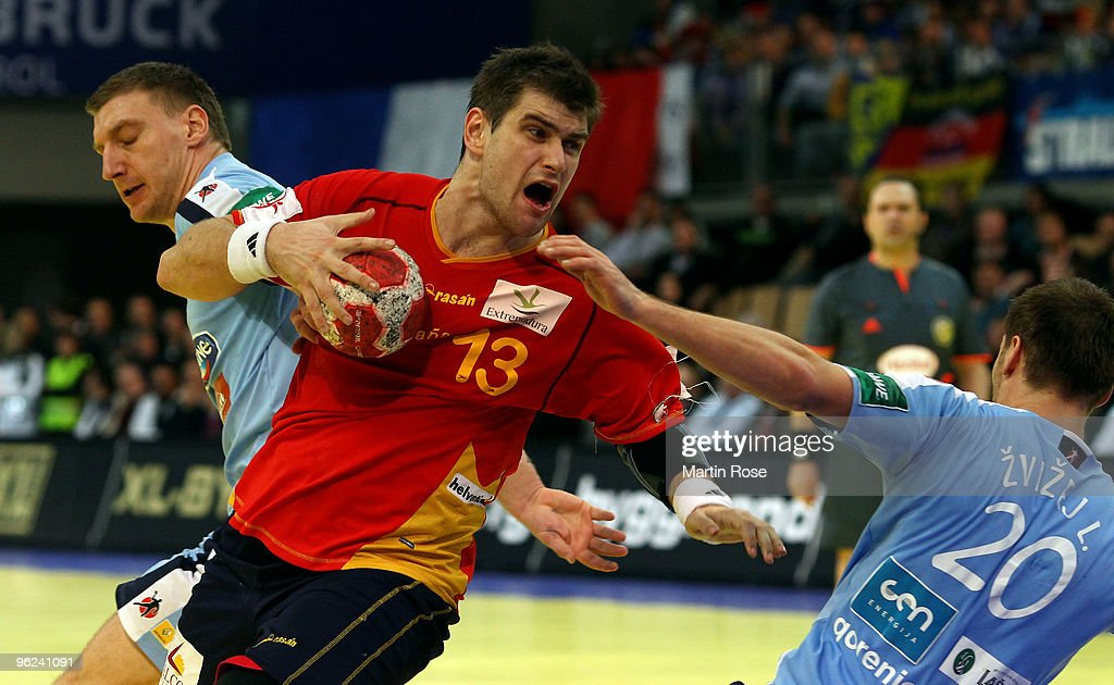 Miladin Kozlina of Slovenia in action with Julen Aguinagalde of Spain during the Men's Handball European main round Group II match between Slovenia...