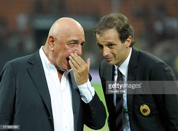 Milan AD Adriano Galliani and head coach Massimiliano Allegri talk during the Berlusconi Trophy match between AC Milan and Juventus FC at Giuseppe...