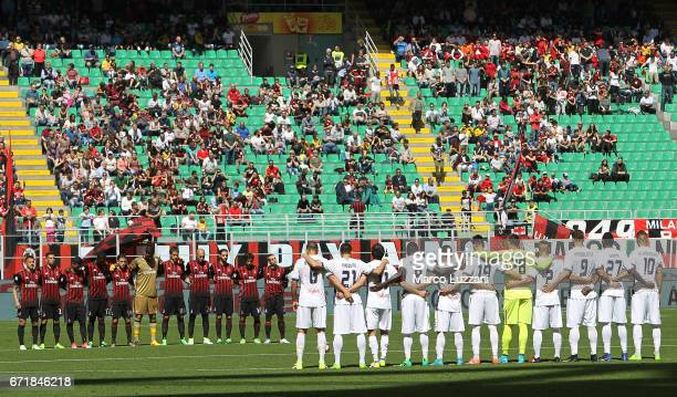 Milan and Empoli FC teams hold a minute of silence for italian cyclist Michele Scarponi before the Serie A match between AC Milan and Empoli FC at...