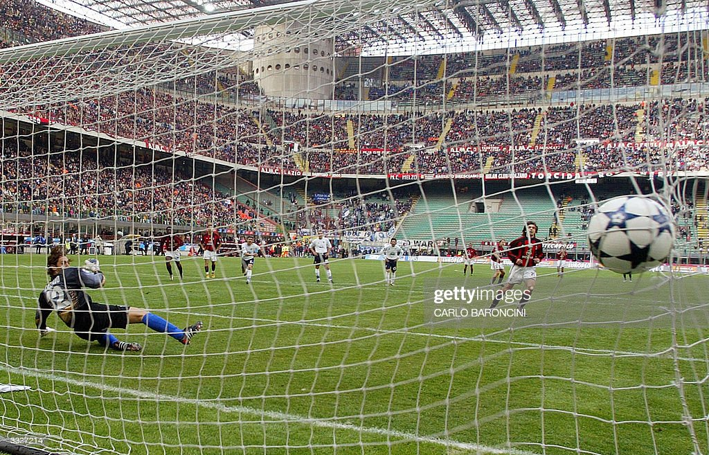 AC Milan Andrea Pirlo scores a penalty against Empoli during their Italian Serie A football match at San Siro stadium in Milan 10 April 2004. AC Milan won the match 1-0. AFP PHOTO/Carlo BARONCINI