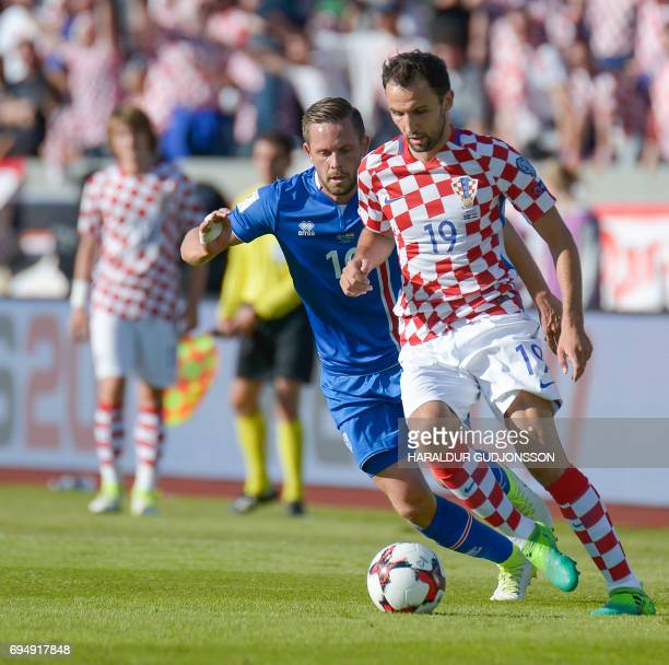 Milan Badelj of Croatia and Gylfi Sigurdsson of Iceland vie for the ball during the FIFA World Cup 2018 qualification football match between Iceland...