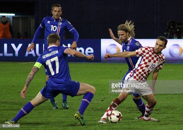 Milan Badelj of Croatia in action against Aron Gunnarsson of Iceland during the FIFA 2018 World Cup Qualifier Group I match between Croatia and...