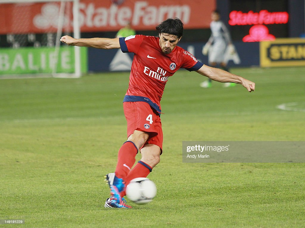 <a gi-track='captionPersonalityLinkClicked' href=/galleries/search?phrase=Milan+Bisevac&family=editorial&specificpeople=600075 ng-click='$event.stopPropagation()'>Milan Bisevac</a> #4 of Paris Saint Germain plays the ball against Chelsea FC during the match at Yankee Stadium on July 22, 2012 in New York City.