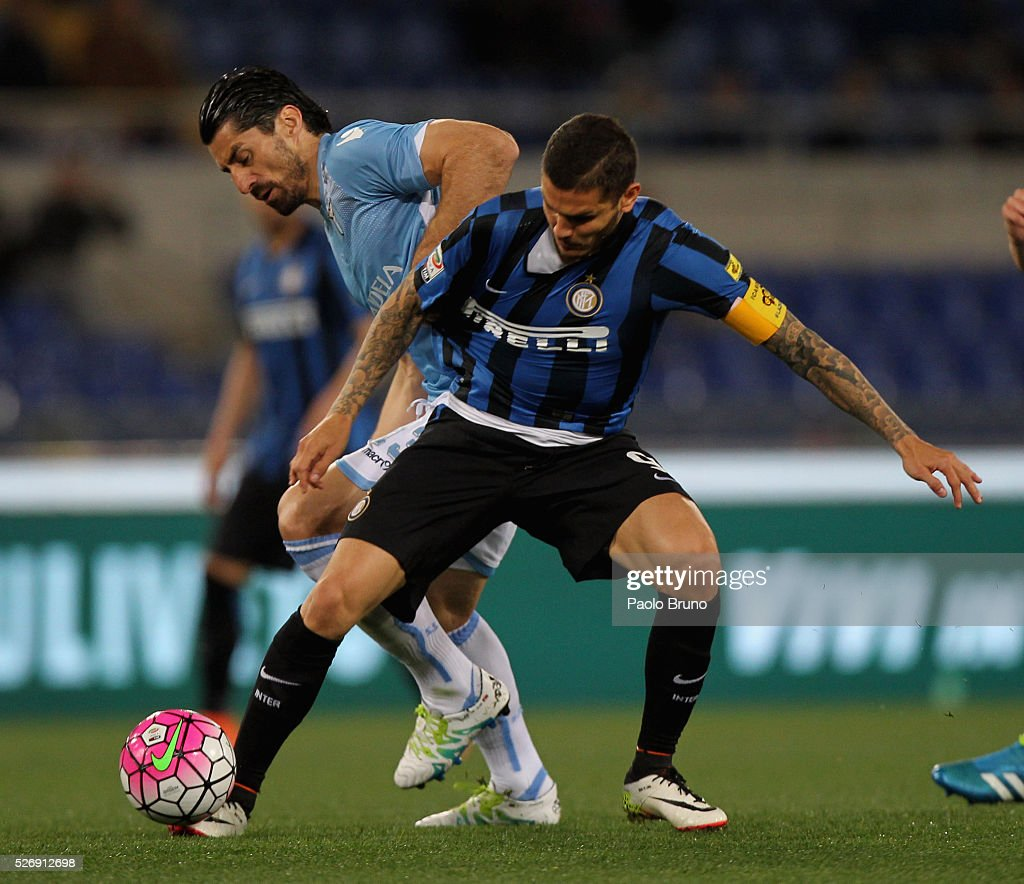 Milan Bisevac (L) of SS Lazio competes for the ball with Mauro Icardi of FC Internazionale Milano during the Serie A match between SS Lazio and FC Internazionale Milano at Stadio Olimpico on May 1, 2016 in Rome, Italy.