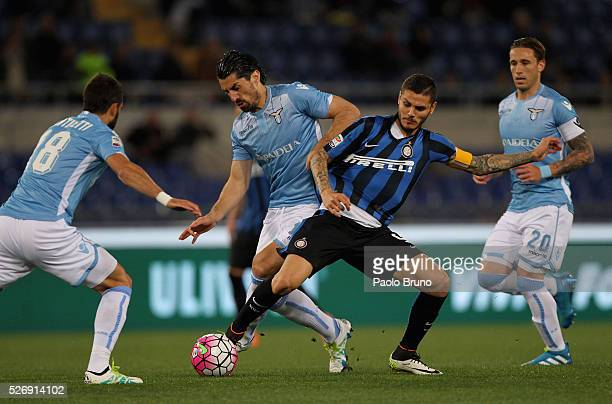 Milan Bisevac of SS Lazio competes for the ball with Mauro Icardi of FC Internazionale Milano during the Serie A match between SS Lazio and FC...
