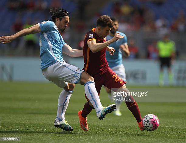 Milan Bisevac of SS Lazio competes for the ball with Stephan El Shaarawy of AS Roma during the Serie A match between SS Lazio and AS Roma at Stadio...