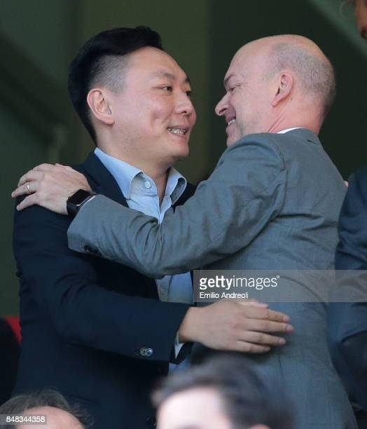 Milan board member David Han Li embraces AC Milan CEO Marco Fassone prior to the Serie A match between AC Milan and Udinese Calcio at Stadio Giuseppe...