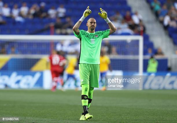 Milan Borjan goalkeeper of Canada celebrates the opening goal of his team during the Group A match between French Guiana and Canada as part of the...