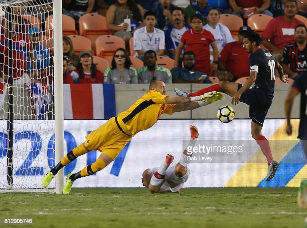 Milan Borjan of Canada make a save before Bryan Ruiz of Costa Rica can get his foot on the ball in the second half at BBVA Compass Stadium on July 11...