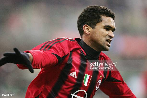 Milan Brazilian midfielder Serginho exults after scoring the winning goal against Cagliari in extra time during an Italian serie A football match at...