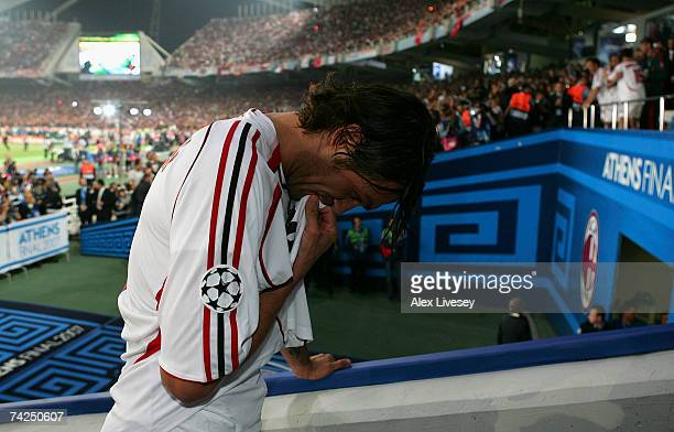 Milan captain Paolo Maldini kisses his shirt as he climbs the steps to receive the trophy following their teams 21 victory during the UEFA Champions...
