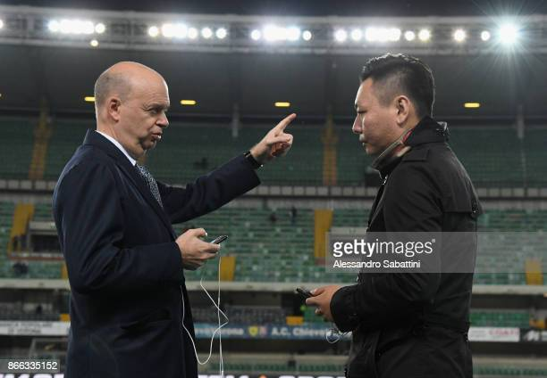 Milan CEO Marco Fassone and AC Milan board member David Han Li looks on before the Serie A match between AC Chievo Verona and AC Milan at Stadio...
