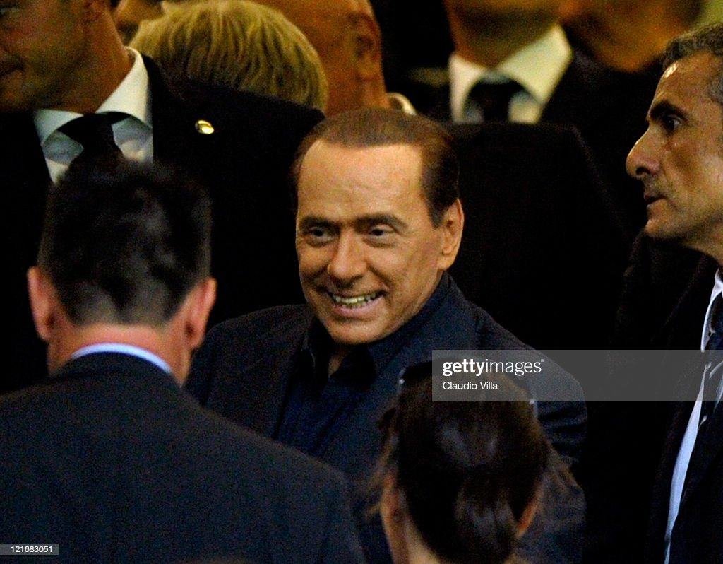 AC Milan chairman <a gi-track='captionPersonalityLinkClicked' href=/galleries/search?phrase=Silvio+Berlusconi&family=editorial&specificpeople=201842 ng-click='$event.stopPropagation()'>Silvio Berlusconi</a> attends the Berlusconi Trophy match between AC Milan and Juventus FC at Giuseppe Meazza Stadium on August 21, 2011 in Milan, Italy.