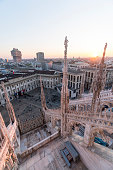 Milan cityscape at sunset: panoramic view from the Milan cathedral (Duomo) rooftop.