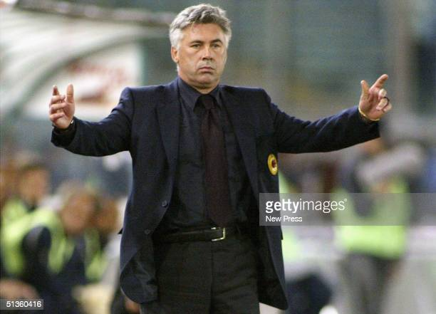 Milan coach Carlo Ancelotti looks dejected during the Serie A match between SS Lazio and AC Milan at the Stadio Olimpico on September 26 2004 in Rome...