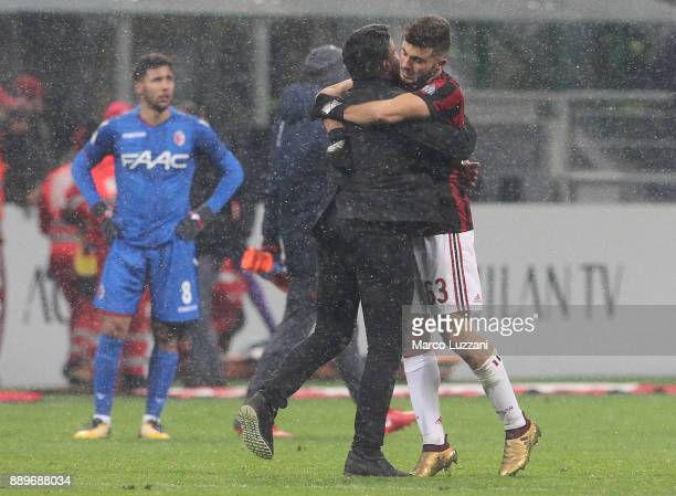 Milan coach Gennaro Gattuso of AC Milan embraces Patrick Cutrone of AC Milan at the end of the Serie A match between AC Milan and Bologna FC at...