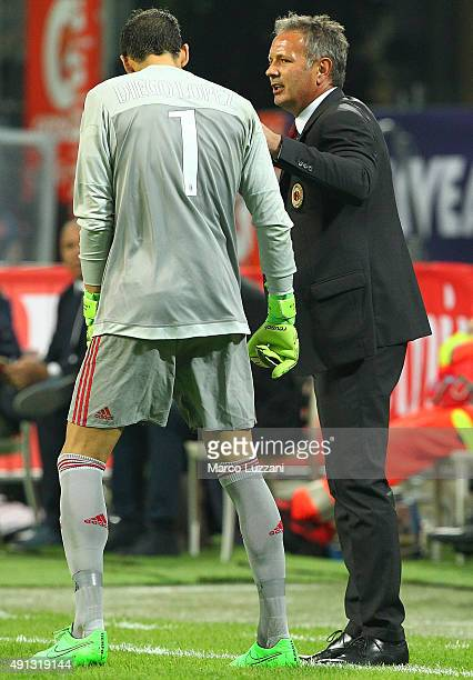 Milan coach Sinisa Mihajlovic issues instructions to his player Diego Lopez during the Serie A match between AC Milan and SSC Napoli at Stadio...