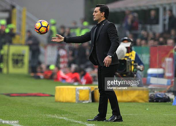 Milan coach Vincenzo Montella attempts to control the ball during the Serie A match between AC Milan and Pescara Calcio at Stadio Giuseppe Meazza on...