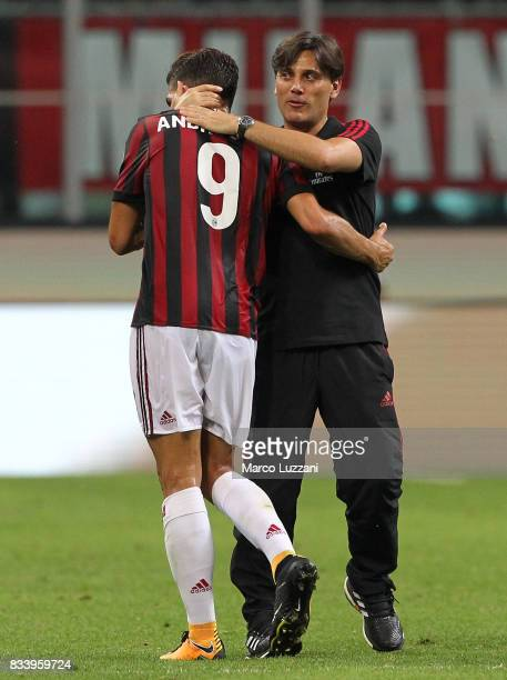 Milan coach Vincenzo Montella embraces Andre Silva at the end of the UEFA Europa League Qualifying PlayOffs round first leg match between AC Milan...
