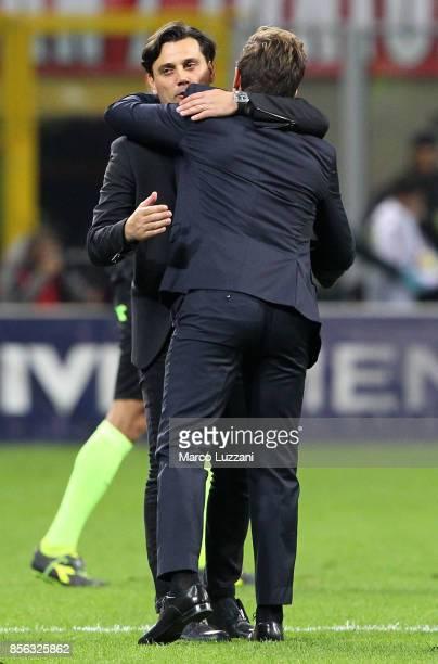 Milan coach Vincenzo Montella embraces AS Roma coach Eusebio Di Francesco at the end of the Serie A match between AC Milan and AS Roma at Stadio...