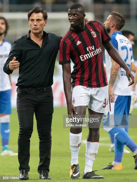 Milan coach Vincenzo Montella embraces M Baye Niang of AC Milan at the end of the UEFA Europa League Third Qualifying Round Second Leg match between...