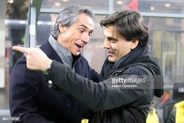 Milan coach Vincenzo Montella greets ACF Fiorentina coach Paulo Sousa before the Serie A match between AC Milan and ACF Fiorentina AC Milan wins 21...