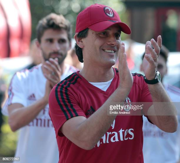 Milan coach Vincenzo Montella greets the fans prior to the AC Milan training session at the club's training ground Milanello on July 5 2017 in...