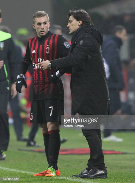 Milan coach Vincenzo Montella issues instructions to his player Gerard Deulofeu during the Serie A match between AC Milan and ACF Fiorentina at...