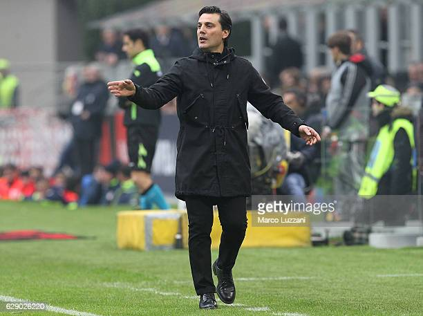 Milan coach Vincenzo Montella issues instructions to his players during the Serie A match between AC Milan and FC Crotone at Stadio Giuseppe Meazza...