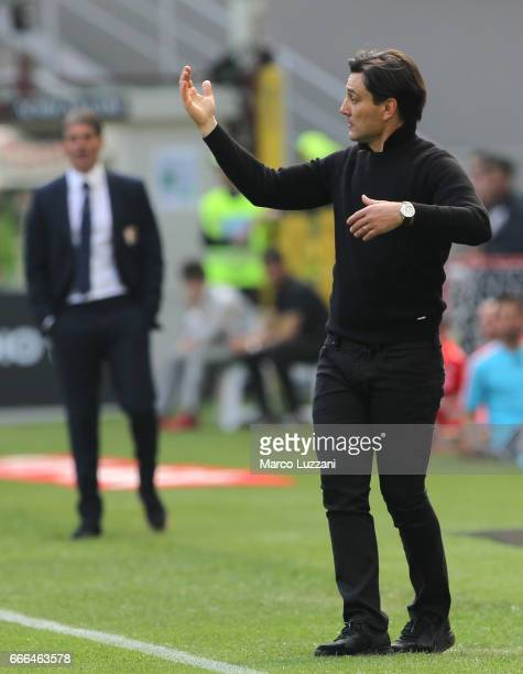 Milan coach Vincenzo Montella issues instructions to his players during the Serie A match between AC Milan and US Citta di Palermo at Stadio Giuseppe...