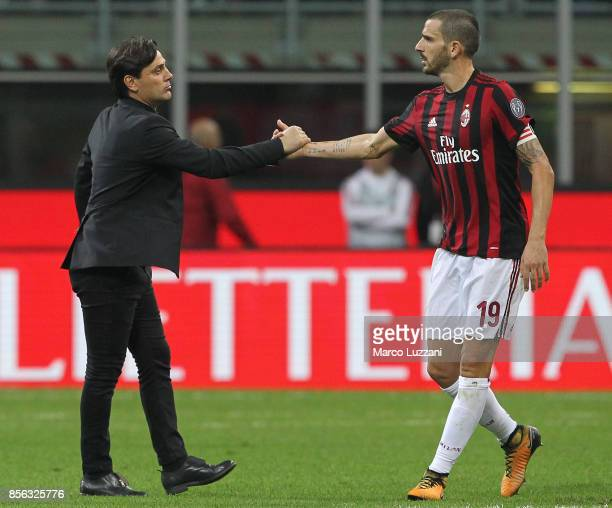 Milan coach Vincenzo Montella shakes hands with Leonardo Bonucci of AC Milan at the end of the Serie A match between AC Milan and AS Roma at Stadio...