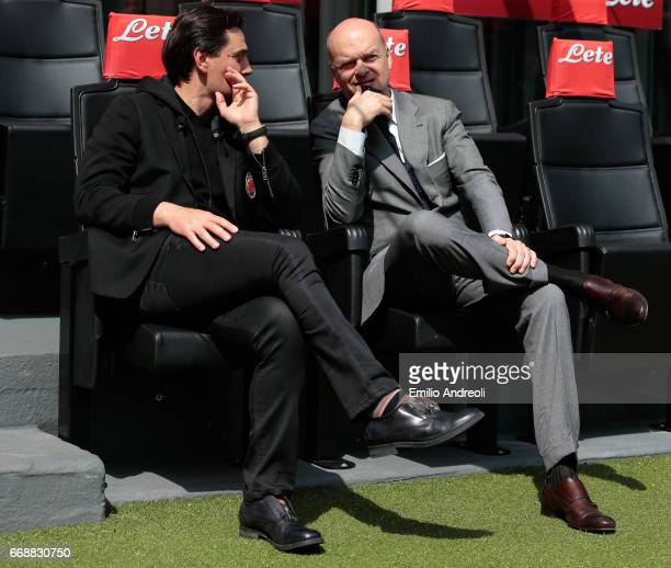 Milan coach Vincenzo Montella speaks to AC Milan CEO Marco Fassone prior to the Serie A match between FC Internazionale and AC Milan at Stadio...