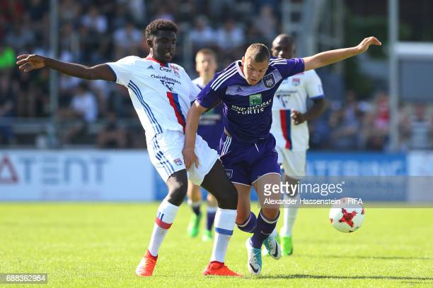 Milan Corryn of RSC Anderlecht is challenged by Bryan Ngwabije of Olympique Lyonnais during the Final match between Olympique Lyon vs RSC Anderlecht...