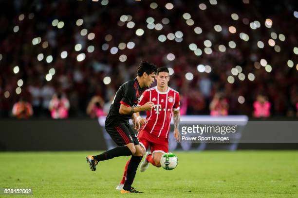 Milan Defender Gustavo Gomez in action against Bayern Munich Midfielder James Rodríguez during the 2017 International Champions Cup China match...