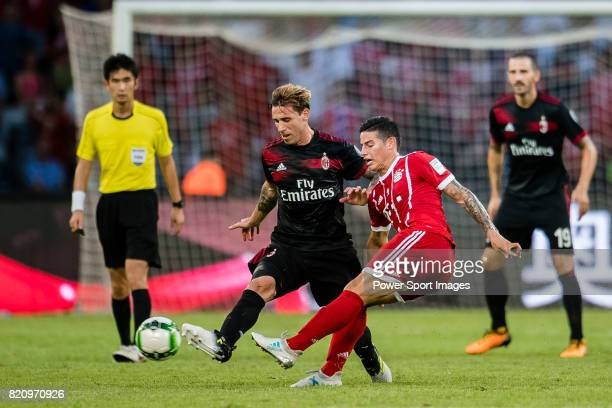Milan Defender Lucas Biglia fights for the ball with Bayern Munich Midfielder James Rodrguez during the 2017 International Champions Cup China match...