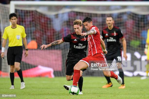 Milan Defender Lucas Biglia fights for the ball with Bayern Munich Midfielder James Rodríguez during the 2017 International Champions Cup China match...