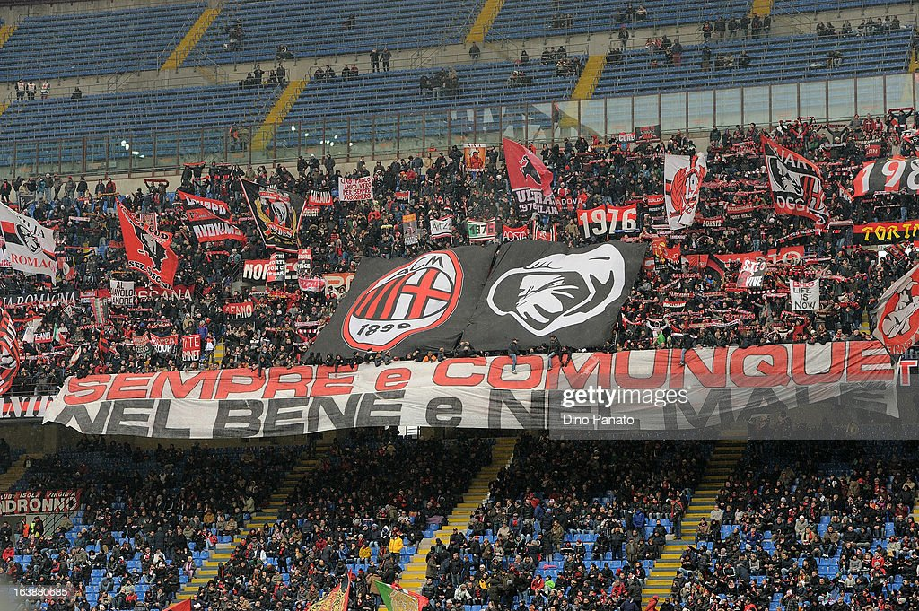 AC Milan fans show a banner as they show their support during the Serie A match between AC Milan and US Citta di Palermo at San Siro Stadium on March 17, 2013 in Milan, Italy.