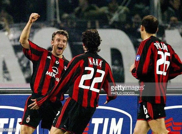 Milan forward Andriy Schevchenko of Ukraine celebrates with teammates Kaka of Brazil and Giuseppe Pancaro after scoring against Juventus in a Serie A...
